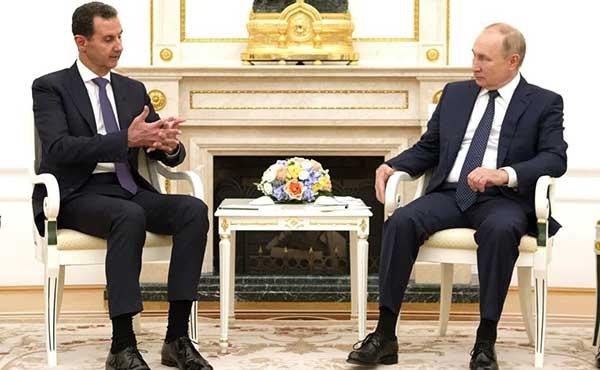 چهره پوتین هنگام دیدار با بشار اسد+عکس