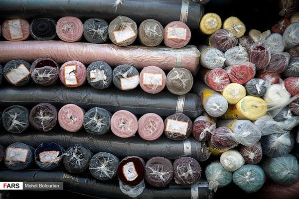 محموله بزرگ قاچاق پارچه و لباس در تهران کشف شد+عکس