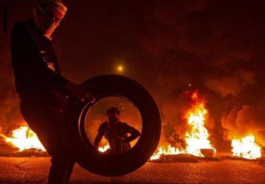 آتشزدن لاستیکها در اطراف فرودگاه نجف اشرف +عکس
