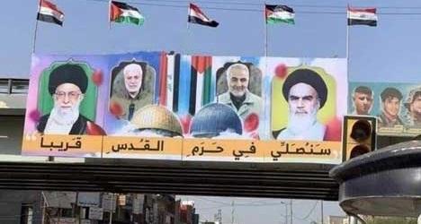 پلاکاردی خاص با تصویر سردار و رهبری در عراق+عکس